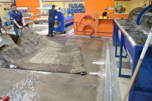 a rug being prepared for the submersion bath