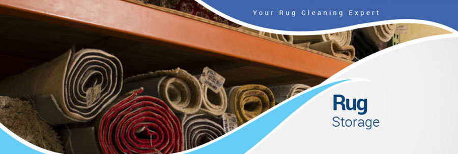 many rolled and wrapped area rugs on storage shelving