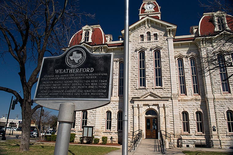 The Weatherford, TX Courthouse and city sign